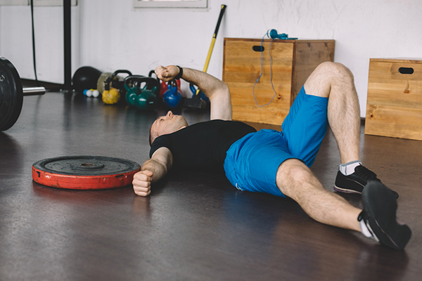 Tired sportsman in the gym